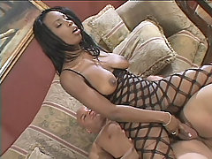 Black babe Lola Lane bounces off a huge dick making her big breasts bounce